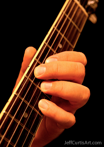 Photo:  Copyright 2010, Jeff Curtis, All Rights Reserved. Canon EOS-5D Mark II Photo. Photography I, Portrait Assignment - Guitar Hand.